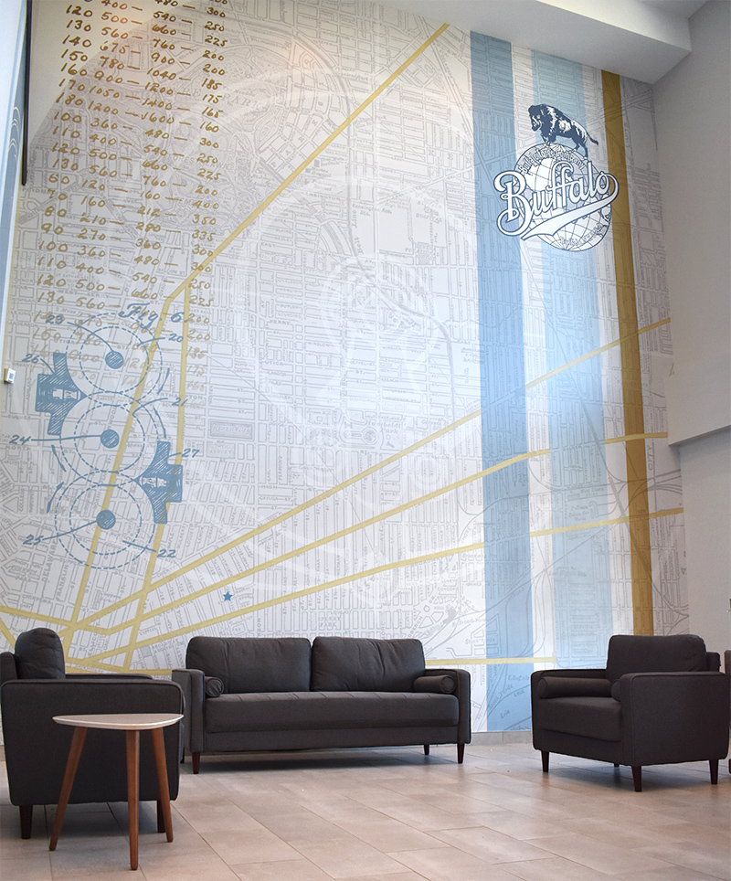 The huge two-story feature wall mural in The Forge's main lobby pairs a vintage map of the Buffalo with historical graphics