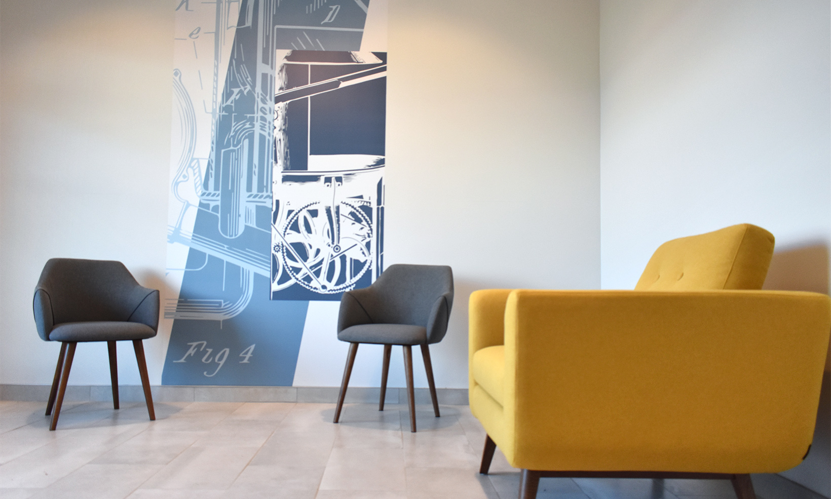 The interior design and wall graphics at The Forge on Broadway work within the brand's color palette to create an engaging space