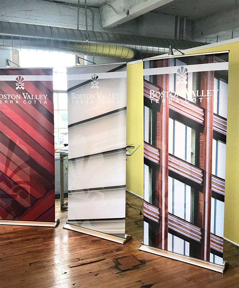 Three retractable trade show banners display some of Boston Valley Terra Cotta's recent projects