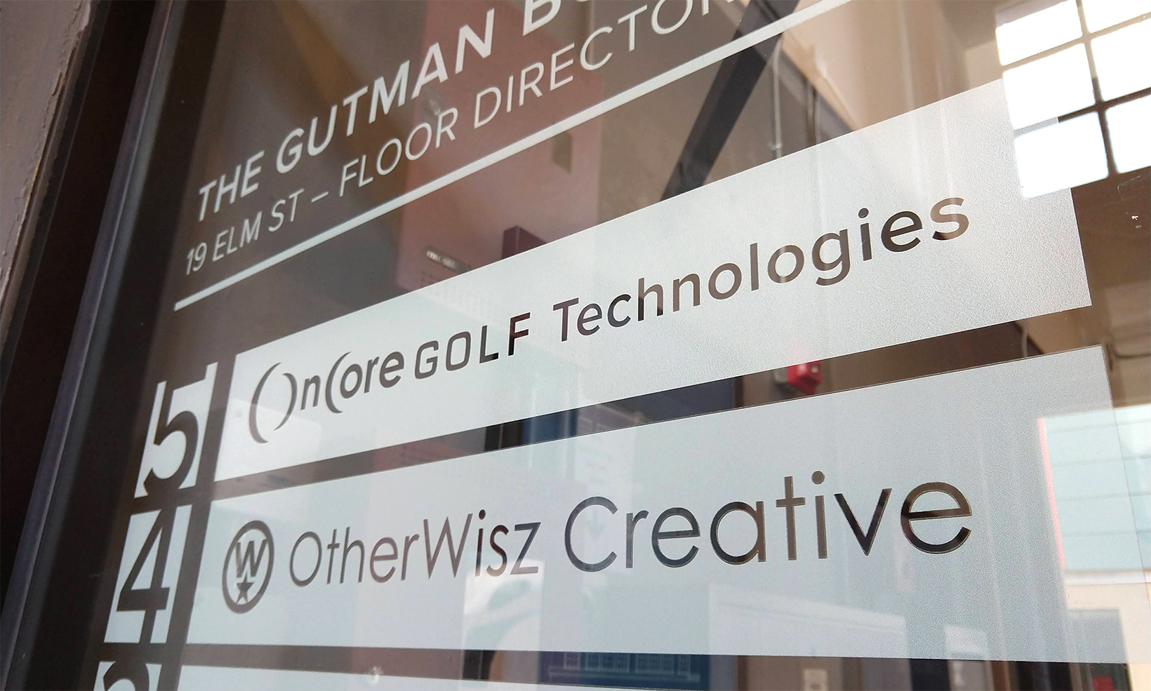 The frosted white vinyl business directory in the lobby of the Gutman Building is made up of individual panels, making it easy to update when needed