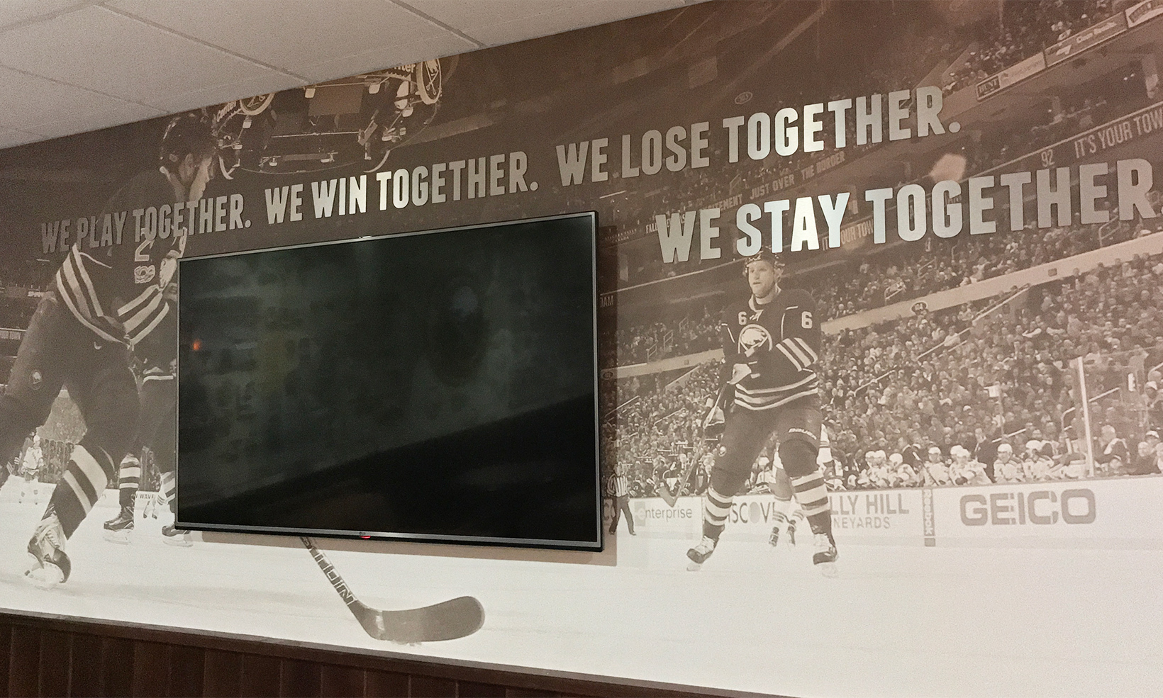 A large inspirational quote rendered in cut aluminum letters welcomes guests to the Alumni Room