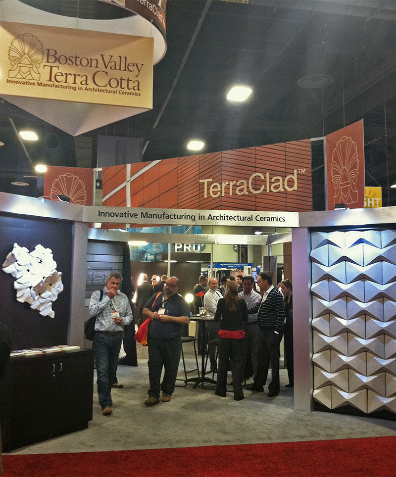 The original trade show display for Boston Valley is an immersive space, showcasing terra cotta products to prospective clients