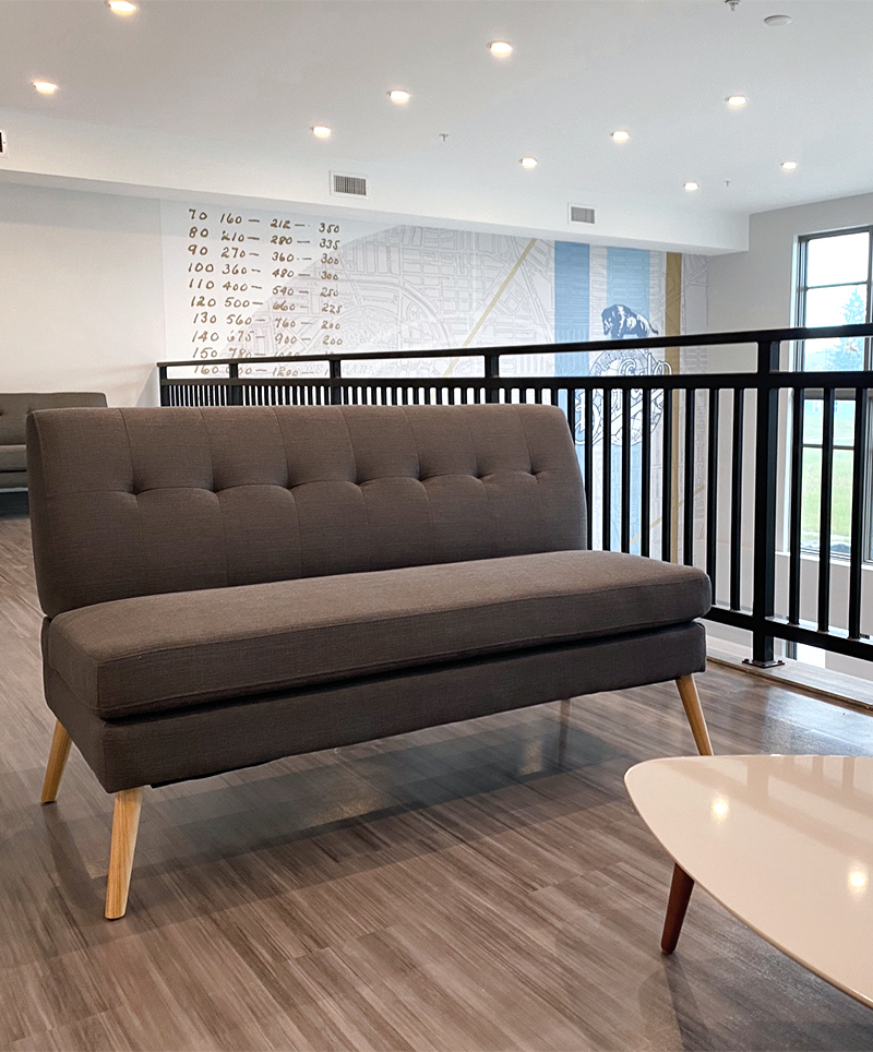 The furniture selected for the Forge Apartments lounge, like this loveseat sofa, was chosen with both aesthetics and functionality in mind