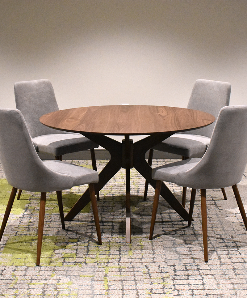 A set of 4 chairs and dining table selected by OW|EN for the Forge on Broadway, as part of their interior design services