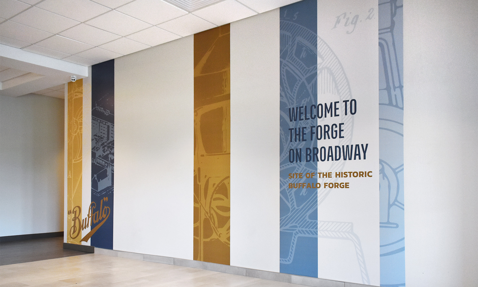 The feature wall mural in The Forge's secondary lobby welcomes you to the building, using bright stripes of color