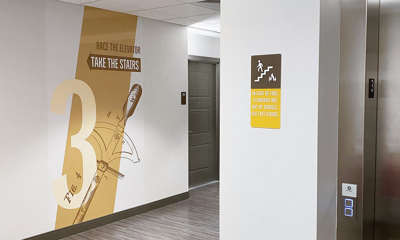 The wall murals in the The Forge Apartments work together with interior signage to create a full wayfinding system