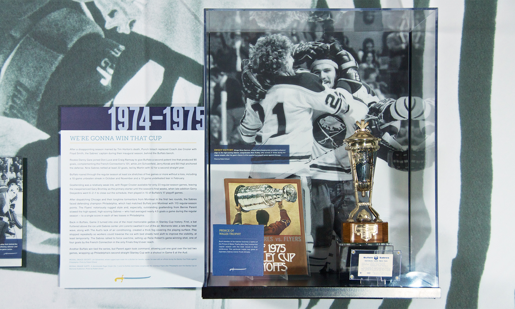The Forging A Connection exhibit features wall mounted display cases full of first year Buffalo Sabres artifacts