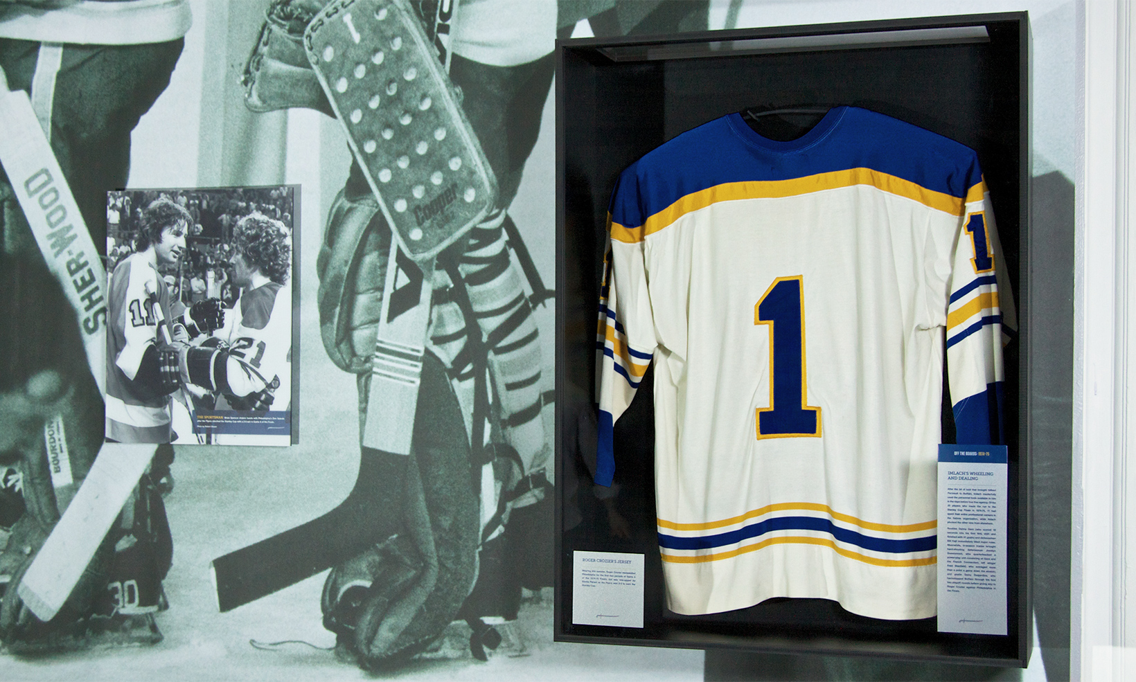 One of the display cases in the Forging A Connection exhibit contains goalie Roger Crozier's #1 jersey
