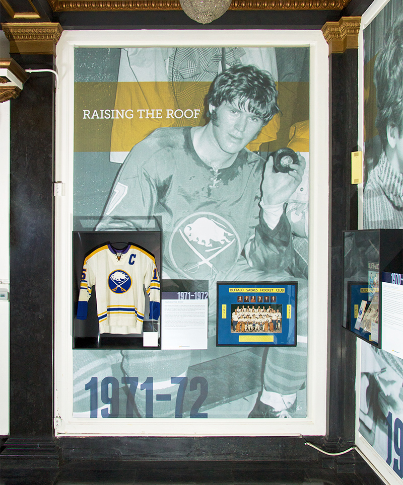 An 11 foot tall print helps create a historical vignette of the Buffalo Sabres' history in the Forging A Connection exhibit