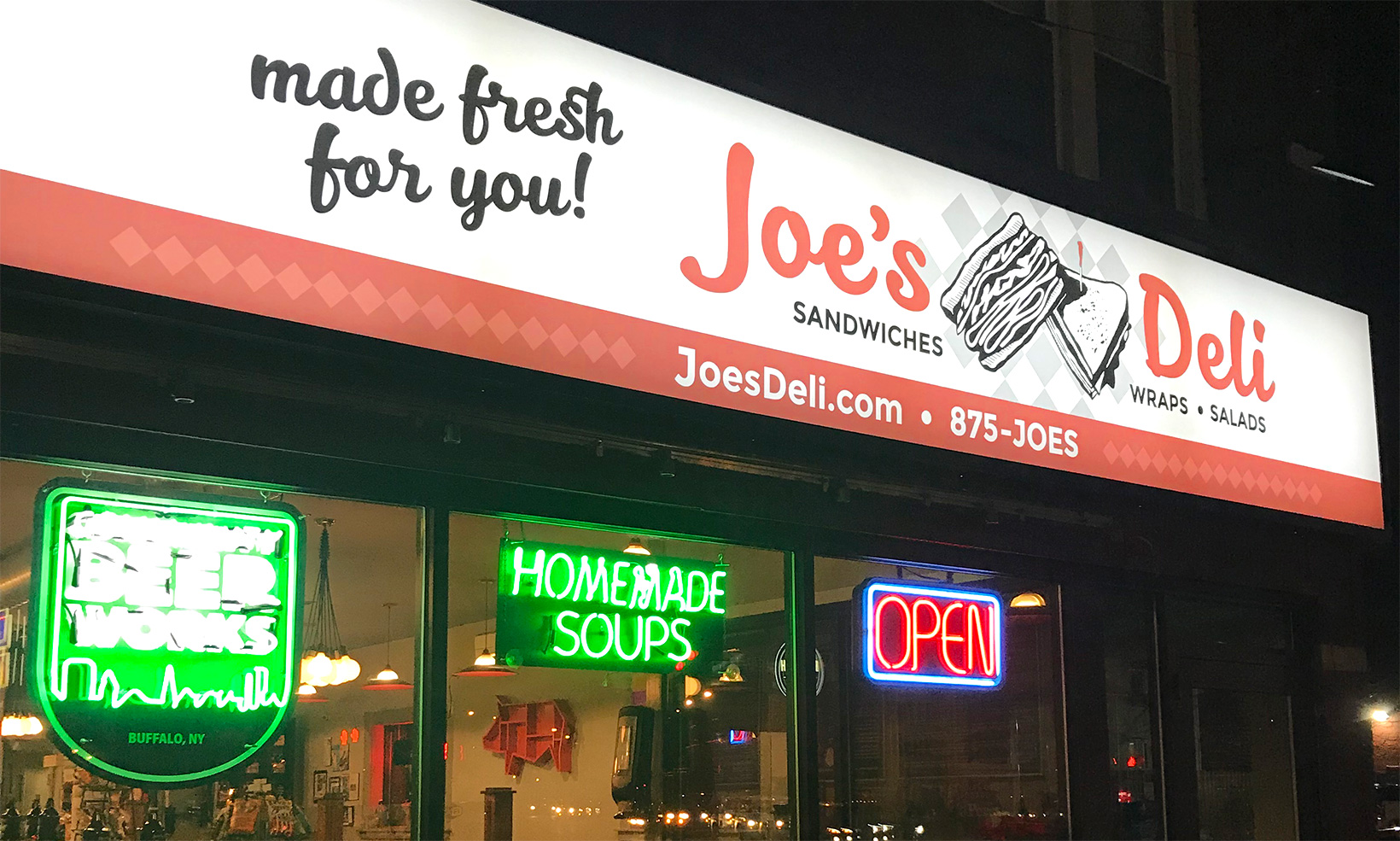 OW|EN designed the exterior building signs at Joe's Deli Hertel – the backlit plexiglass signage displays the restaurant's brand and tagline