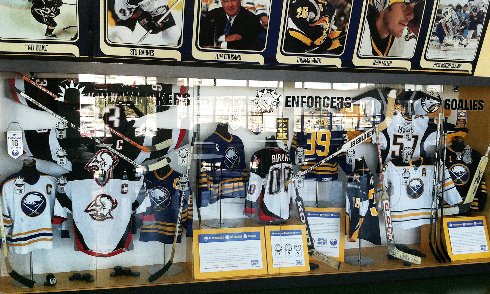 The Playmakers, Enforcers, and Goalies exhibit, designed by OW|EN, organizes Sabres' players into one of three categories