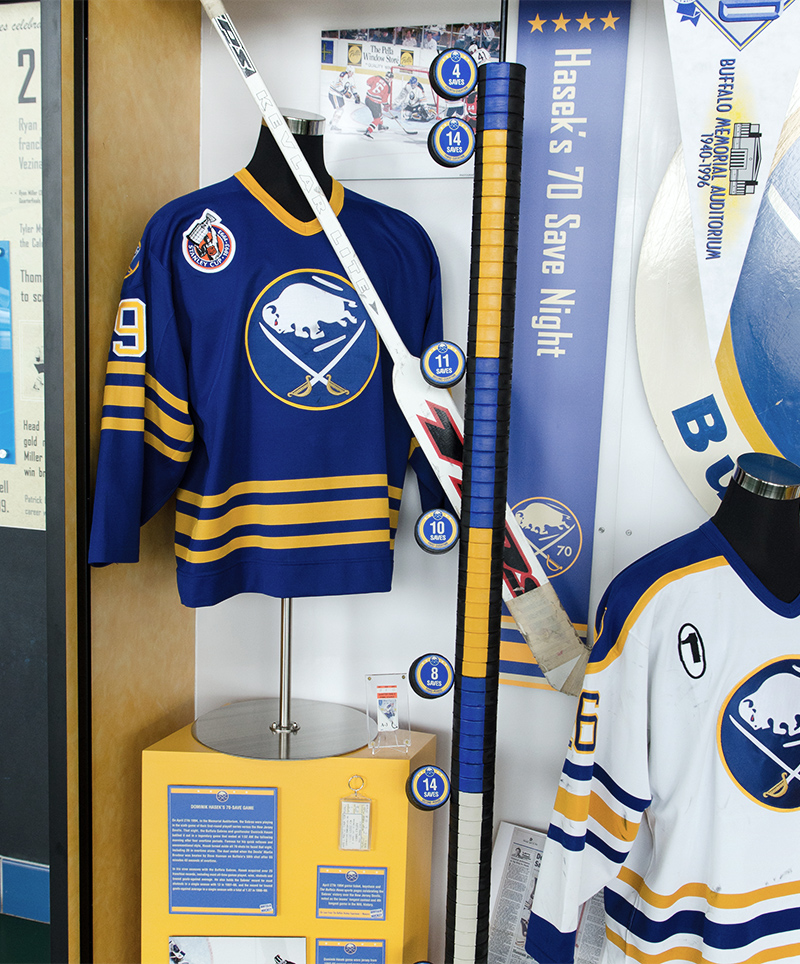 A custom-designed display within the Sabres' 40th Anniversary exhibit consists of a column of 70 hockey pucks to commemorate a 70 save game