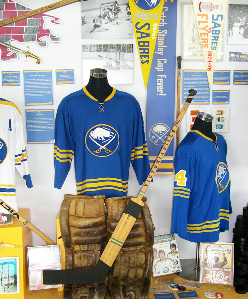 The Sabres 40th Anniversary Exhibits combines hockey memorabilia and artifacts with pennants, custom displays, and informational panels