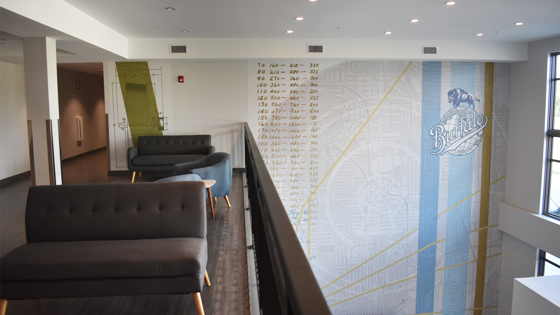 The featured wall mural and lounge interior design at The Forge Apartments