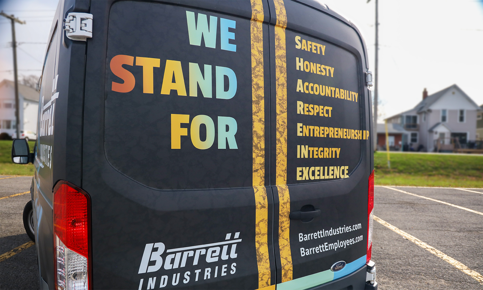 This custom vehicle wrap designed for Barrett Industries displays the company values to drivers behind the van
