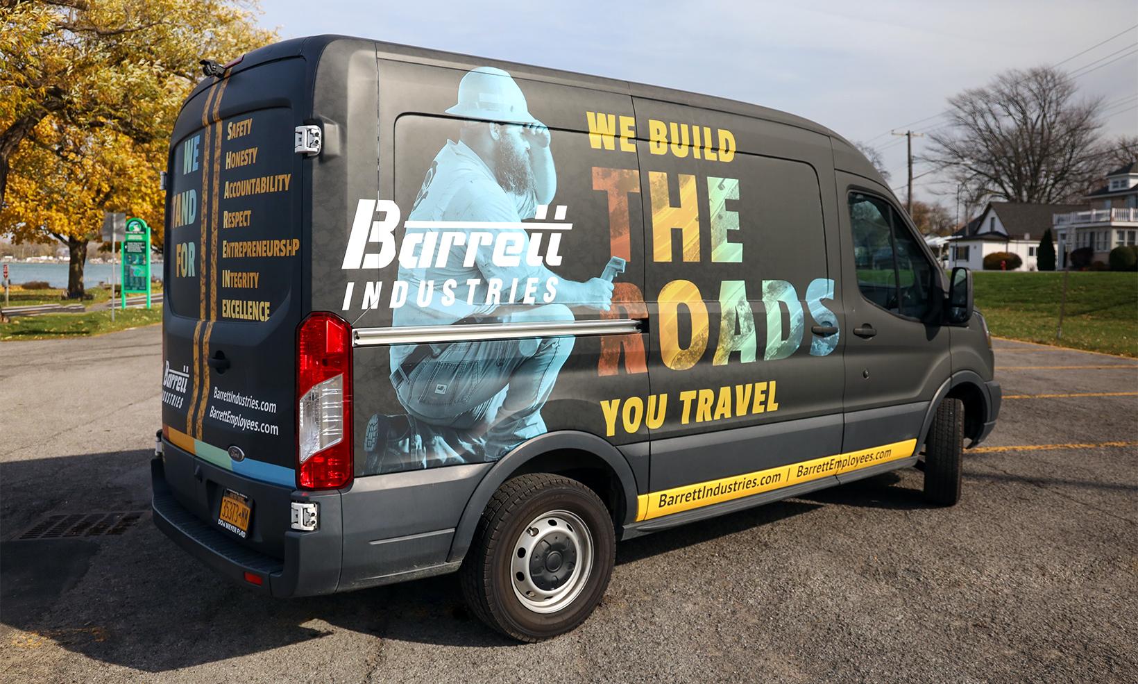 OW|EN designed a custom vehicle wrap for Barrett Industries that takes their brand on the road